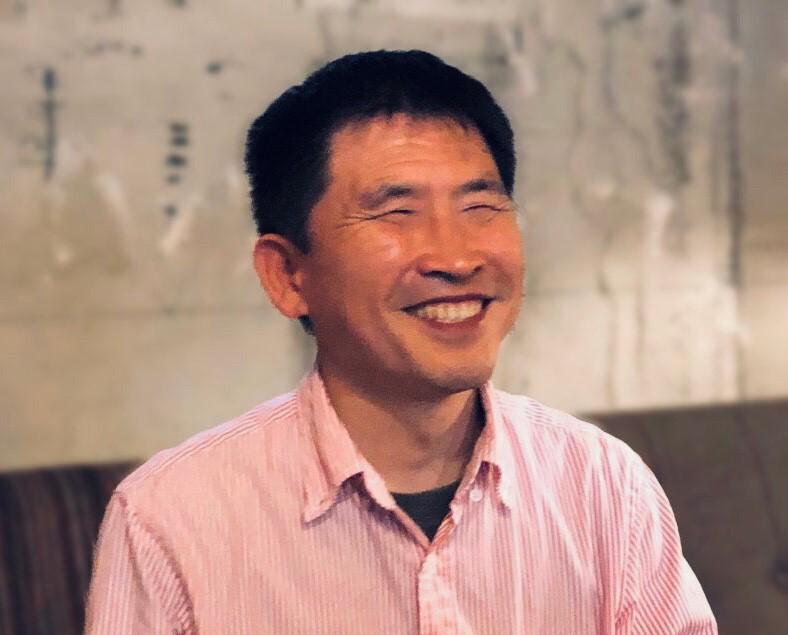 満面の笑顔でお話する大川さん