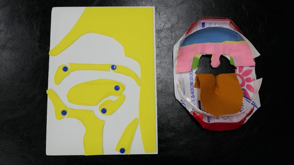 厚紙や布などを使った人体の一部の模型の画像